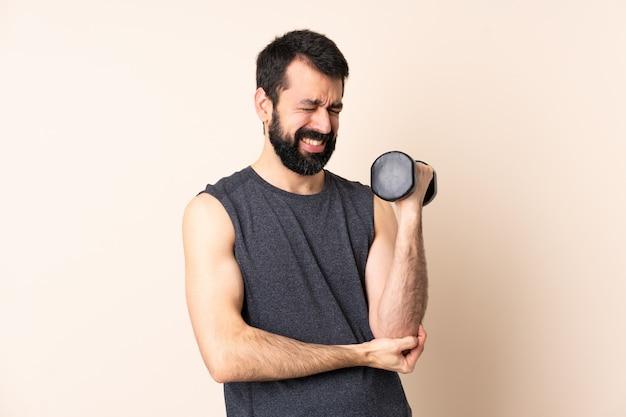 Caucasian sport man with beard making weightlifting