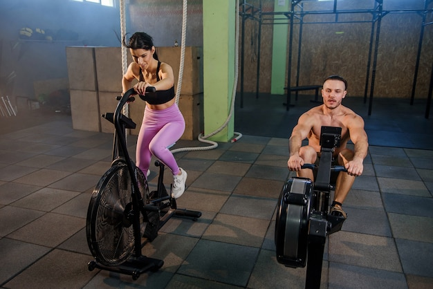 Caucasian sport man and woman during training in the gym.