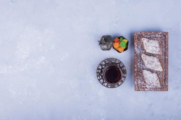 Caucasian tea set with metallic tea glass and pastry platter, top view
