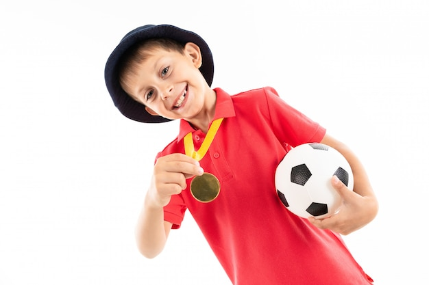 Caucasian teenager boy winner of soccer competition, picture isolated