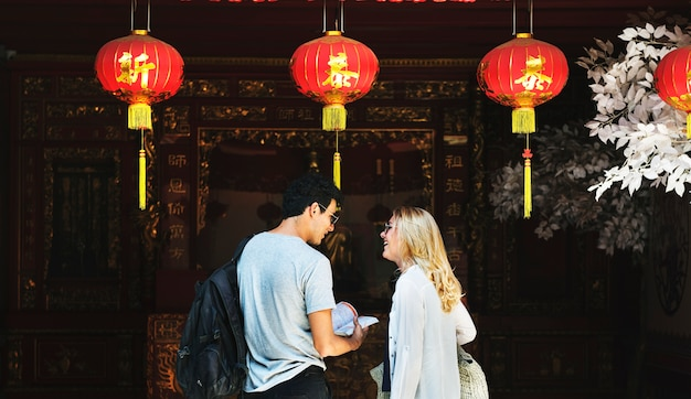 Caucasian tourist couple in chinese joss house