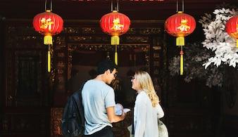 Caucasian tourist couple in chinese joss house
