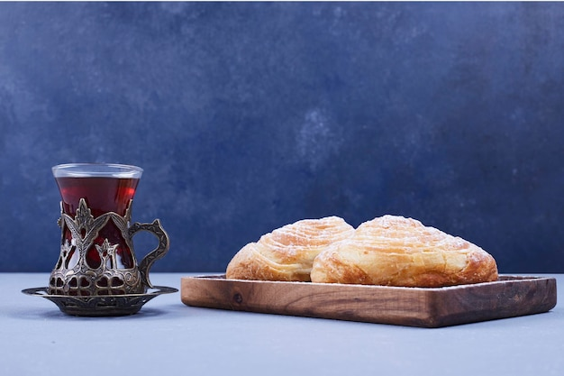 Caucasian traditional pastries with a glass of tea, side view. high quality photo