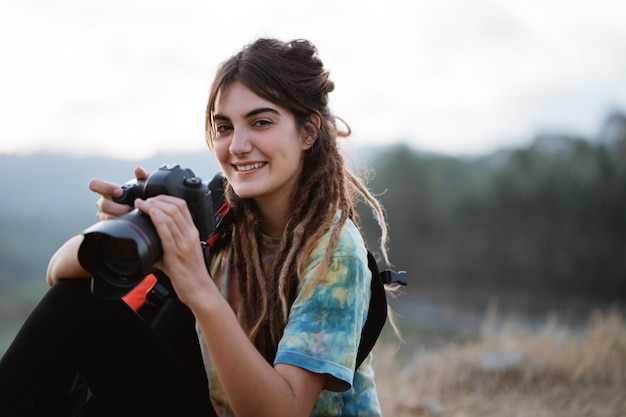 Caucasian woman alone enjoy the beauty of nature with camera