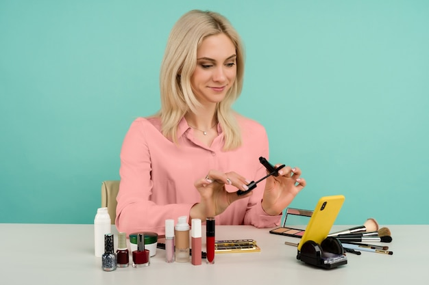 Caucasian woman blogger presenting beauty products and broadcasting live video