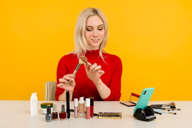 Caucasian woman blogger presenting beauty products and broadcasting live