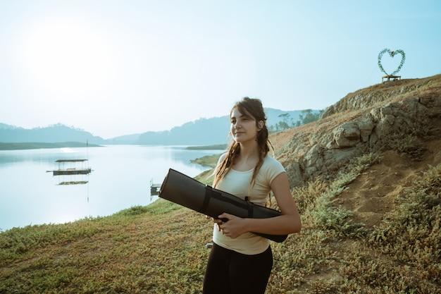 Caucasian woman carrying mattress