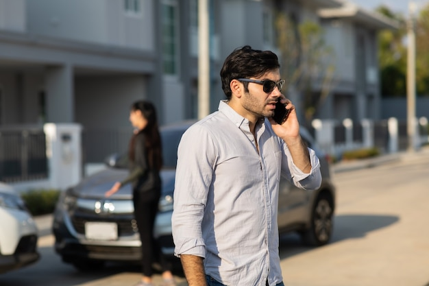 Caucasian woman driver making phone call to insurance agent after traffic accident. accident. car insurance an non-life insurance concept.