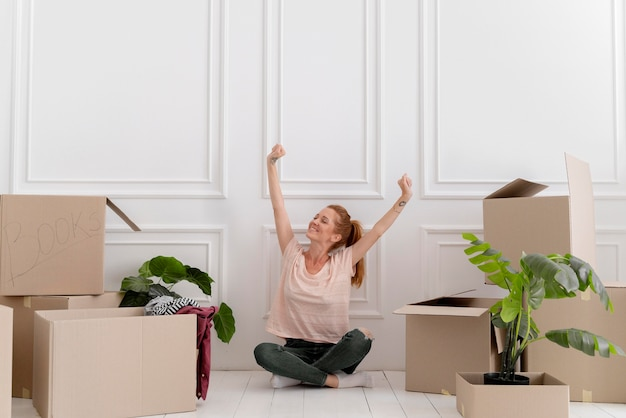 Caucasian woman getting ready to move in a new home