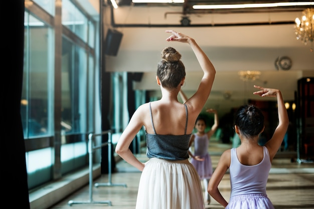 A caucasian woman and girl practising ballet