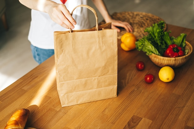 Caucasian woman holding eco paper shopping bag