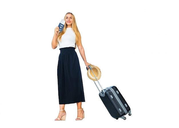 Caucasian woman holding tourist passport and dragging luggages isolated on white