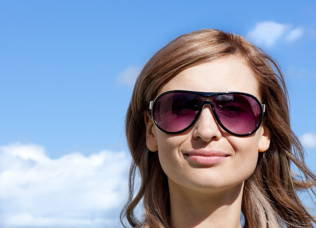 Caucasian woman is wearing glasses outdoor