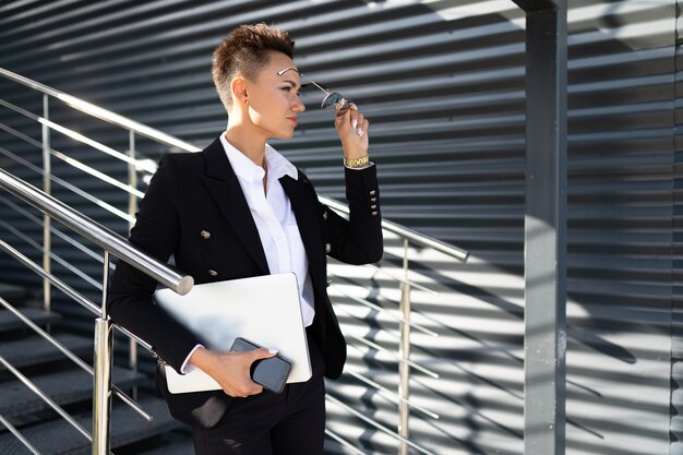 Caucasian woman in office clothes at stairs