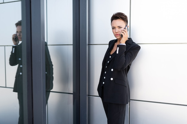 Caucasian woman in office clothes waits colleague