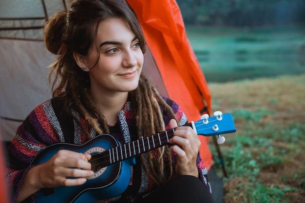 Caucasian woman playing guitar after wake up