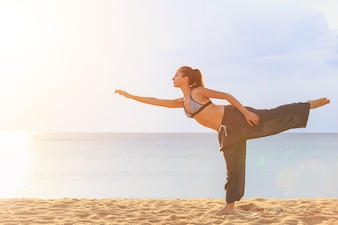 Caucasian woman playing Yoga and exercise on the tropical beach