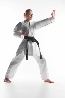 Caucasian woman practicing karate full shot