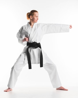 Caucasian woman practicing karate