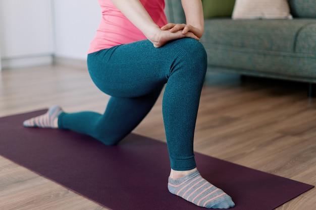 Caucasian woman practicing yoga at home