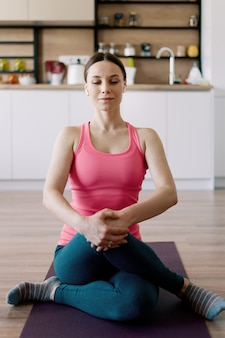 Caucasian woman practicing yoga at home