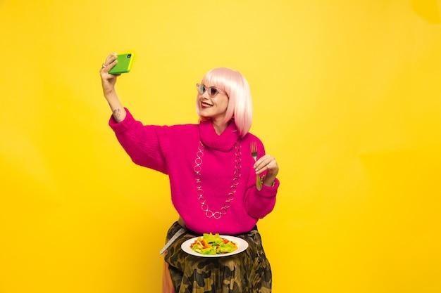 Caucasian woman's portrait on yellow