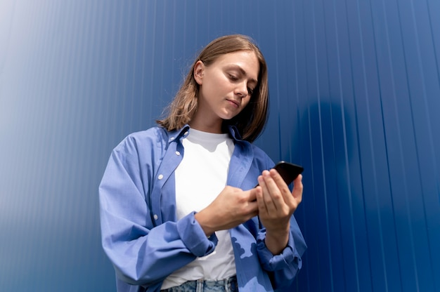 Caucasian woman texting someone on her smartphone