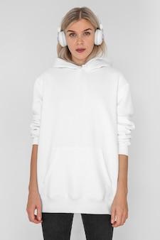 Caucasian woman wearing a white hoodie