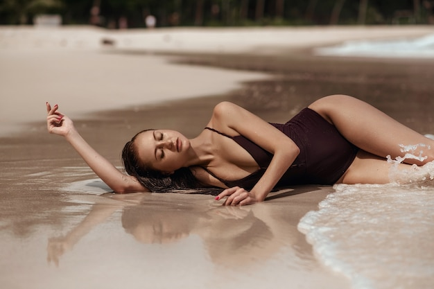 Caucasian woman with freckles on her relaxing on the sea