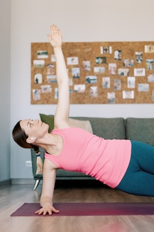Caucasian woman work out at home