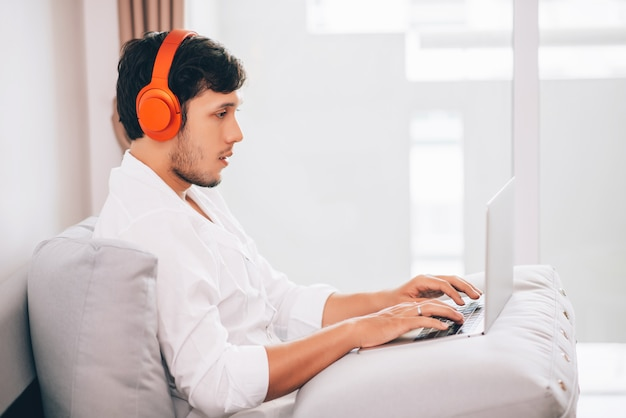 Caucasian young handsome business man working on laptop computer
