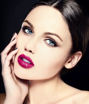 Caucasian young woman model with bright makeup, perfect clean skin and colorful pink lips