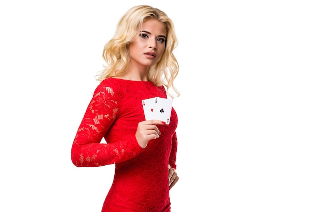Caucasian young woman with long light blonde hair in evening outfit holding playing cards. isolated. poker