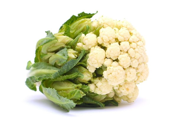 Cauliflower with green leaves isolated on white background