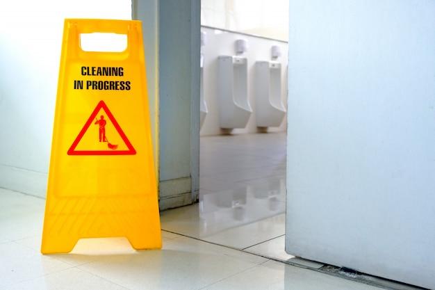Caution wet floor label in toilet