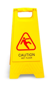 Caution wet floor sign isolated on white.