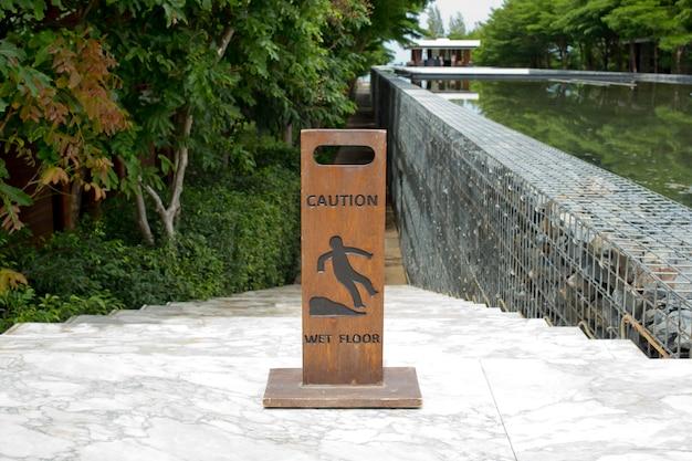 Caution wet floor wooden sign board