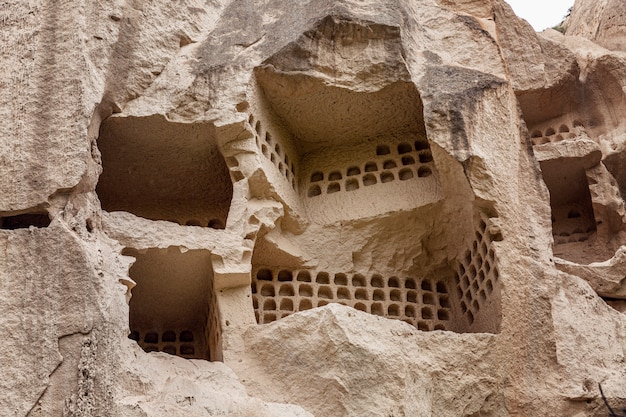 Cave in the rocks in the valley of cappadocia. close-up. tourism and travel.