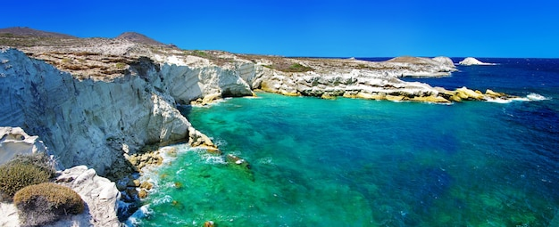 Caves and rock formations by the sea at kleftiko area on milos island, greece