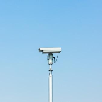 Cctv camera on blue sky