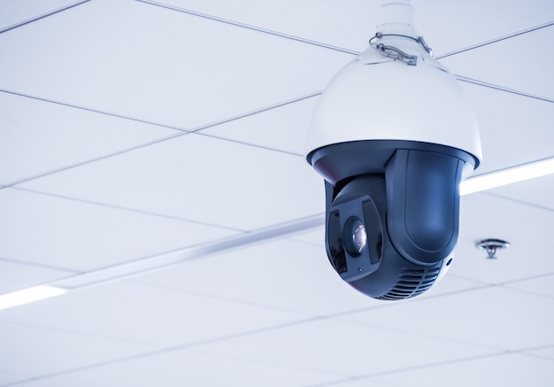 Cctv camera mounted on the ceiling in the office building. and various public places.