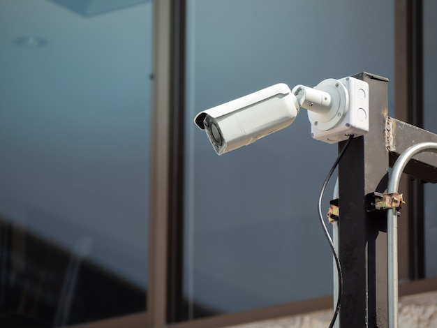 Cctv camera security on the pole in the car parking