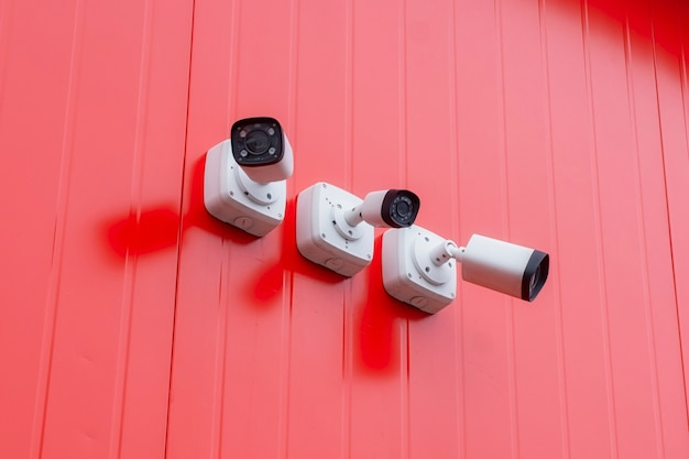 Cctv monitoring. outdoor video surveillance camera for object protection on the red building.