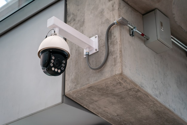 Cctv security camera installed on concrete building.