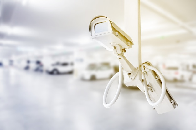 Cctv security camera with car parking background