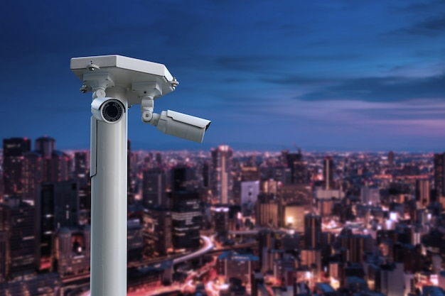 Cctv security camera with cityscape at night