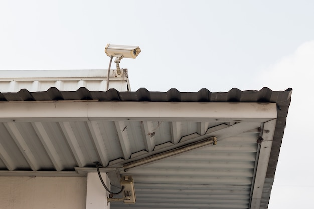 Cctv surveillance camera on the roof in sanny day