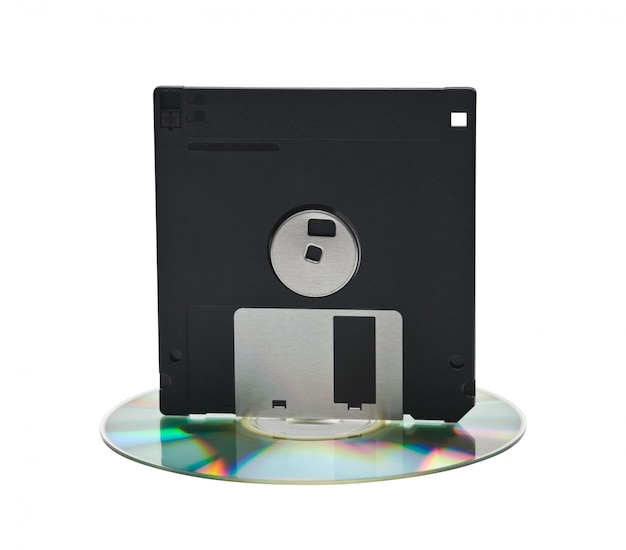 Cd and floppy disk isolated on white