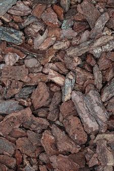 삼나무 껍질, 오래된 갈색 뿌리 덮개 칩, 으깬 소나무 껍질 질감, 오래된 트렁크 장식