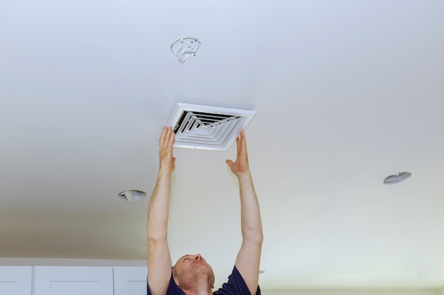 Ceiling mounted air conditioner. new white air conditioning vent closeup